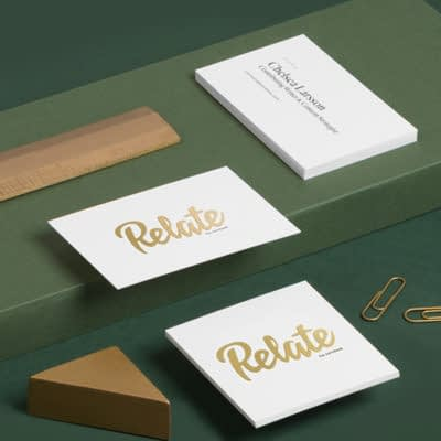 Relate gold foil business cards on green background