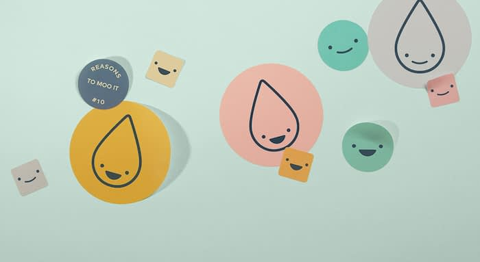 Small square stickers, medium and big round stickers in various colors and designs including smiley faces and the MOO drop logo