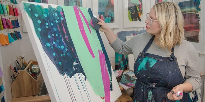 Sticks + Ink painting in her studio
