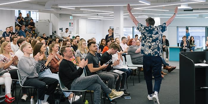 MOO all hands meeting showing good company culture with all employees interacting