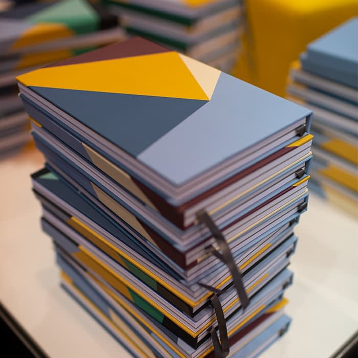 Pile of hardcover notebooks
