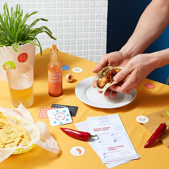 Taco restaurant table with marketing materials