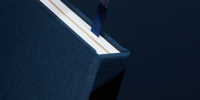 Dark blue hardcover notebook with ribbon
