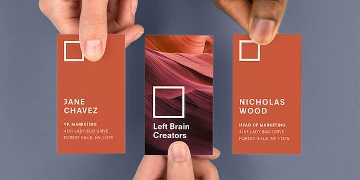 People holding 3 business cards