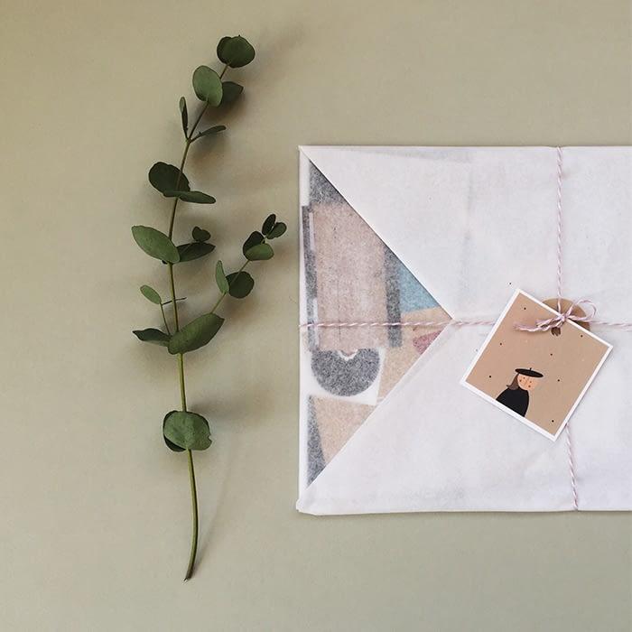 Gulligul square business card on envelope