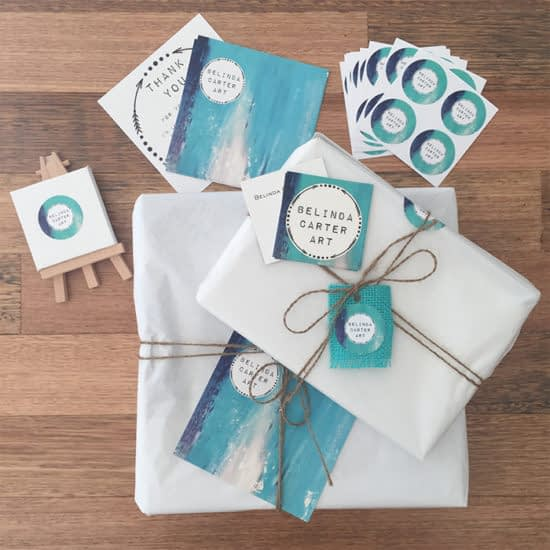 Belinda Carter stickers and business cards on packages