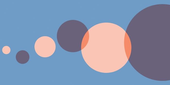 Light orange and dark transluscent orange circles overlapping on a blue background