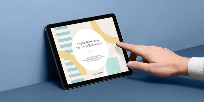 hand touching a tablet to open a digital marketing ebook
