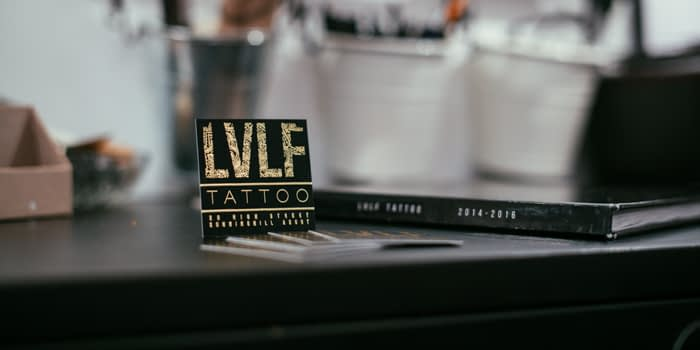 LVLF gold and black business card