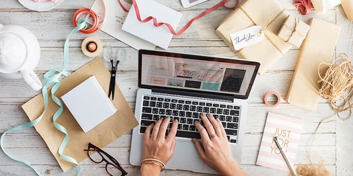 Typing on laptop at desk