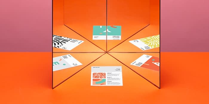 Mirror reflecting different creative print materials to tell a consistent brand story