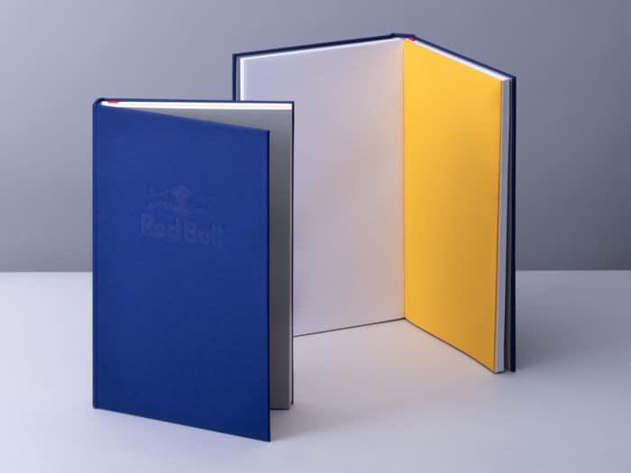 Redbull blue notebooks with yellow central pages