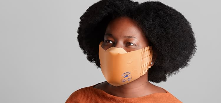 woman wearing an orange custom face mask made of recycled paper