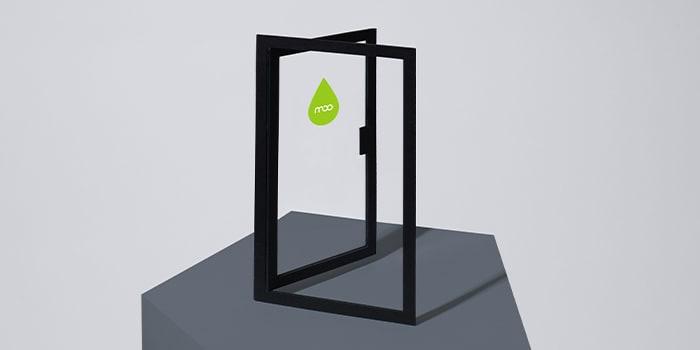 Open glass door with a MOO logo