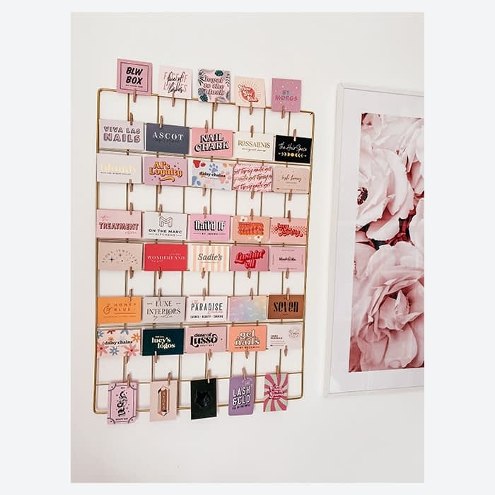 Wall grid with a collection of MOO business cards by Lucy's Logos