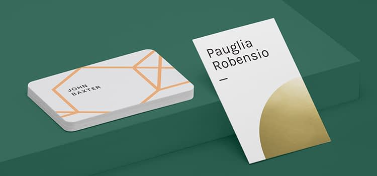 Gold Foil Business Card and Spot gloss business card on green background for the holiday