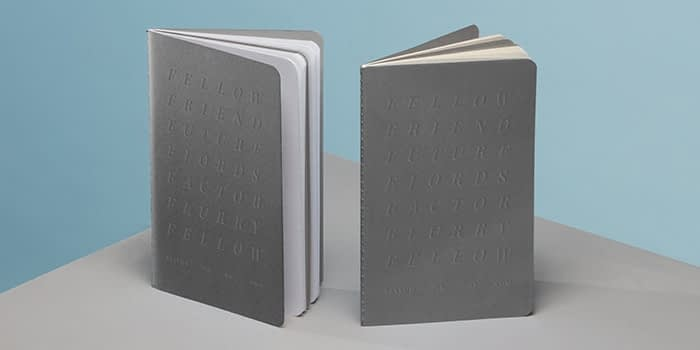 Fellow Inc agency grey softcover notebooks with debossed design by MOO