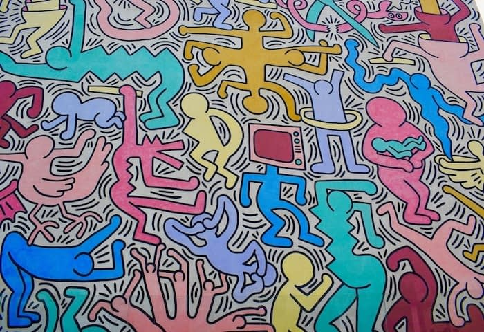 Colorful mural with various characters by Keith Haring