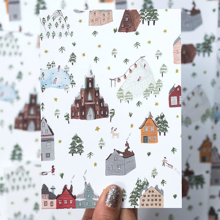 Sara Boccaccini Meadows holiday card with snowy mountains and houses