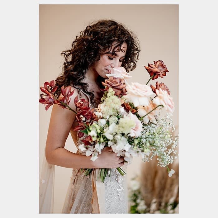 Bride with a wedding bouquet by Rooted in Rosemary floral design studio in Oxford