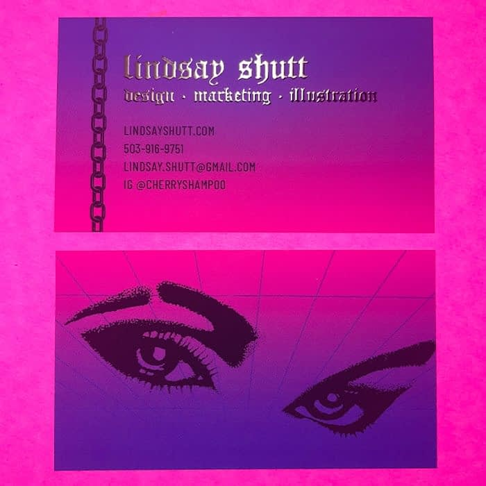 Purple and fuchsia business card with gothic text in silver foil. There is a pair of eyes on the back of this card designed by Lindsay Shutt