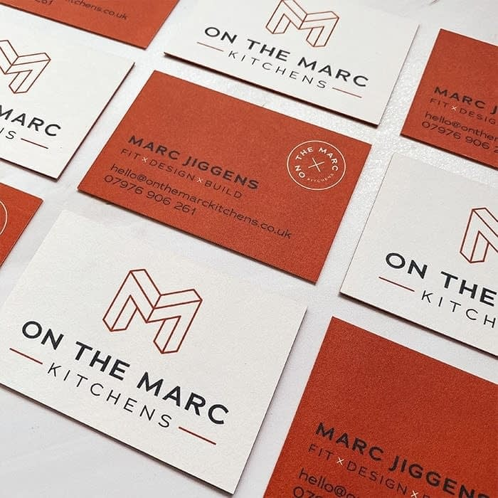On the Marcs orange business cards by Lucy's Logos