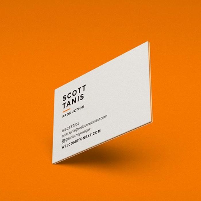 Minimalist business card design against an orange background