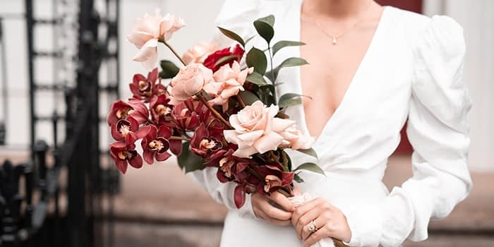 Bride holding a wedding bouquet by Rooted in Rosemary floral design studio in Oxford