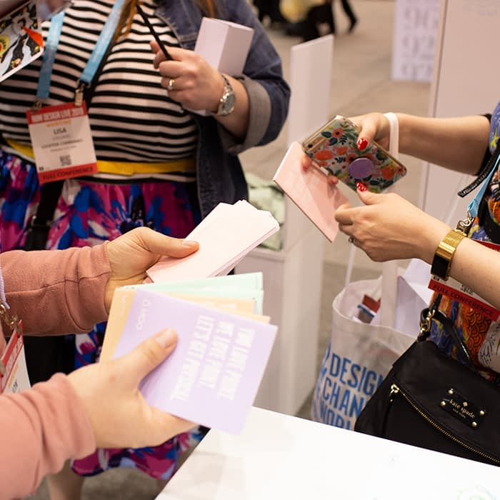 People looking at cards at trade show