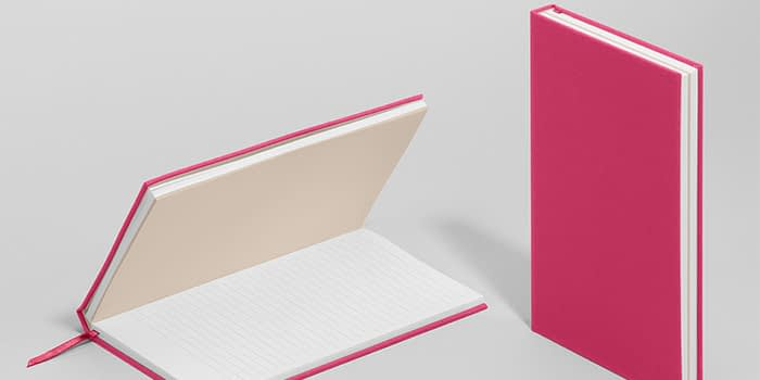 MOO hardcover notebook in new pink punch color, shown both open with lined paper and closed