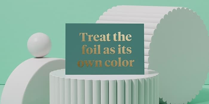 Green postcard with gold foil text saying treat the foil as its own color