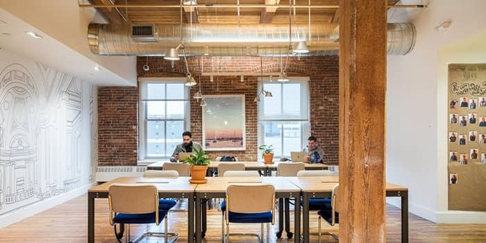 People working in a WeWork office space