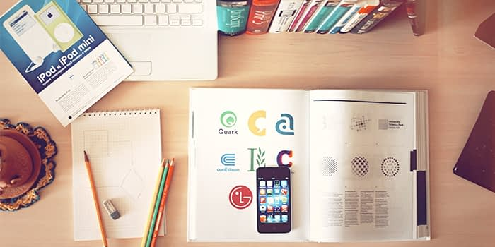 Logo ideas in a book, phone and laptop