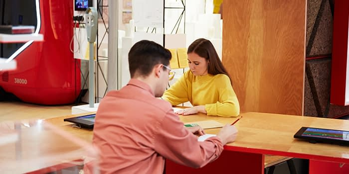 Two people working together at a table