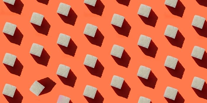 White cubes on an orange background, with all the cubes in the same position except one