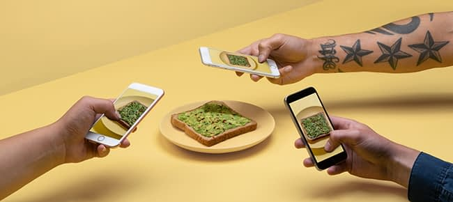 people taking picture of an avocado toast