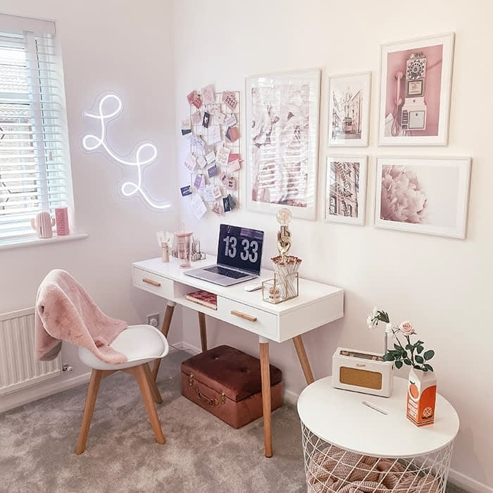 Lucy's Logos home office with prints and a neon sign on the wall