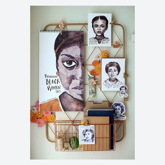 Phenomenal Black Women calendar and postcards by Lydia Makepeace on a wall grid