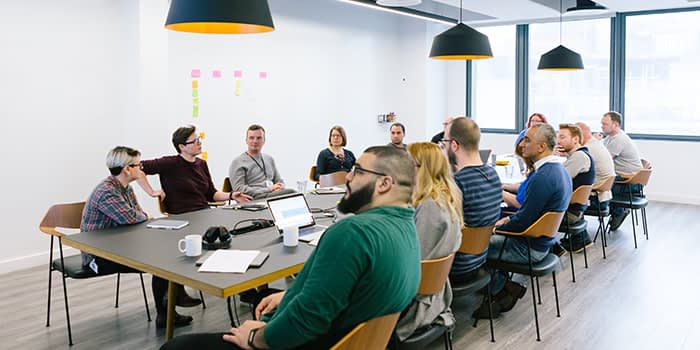 Employees discussing ideas in a meeting room
