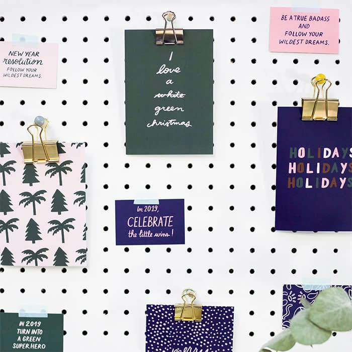 Melanie Johnsson green and blue holiday cards on wall