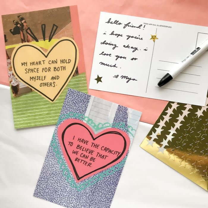 2 Paper Puso postcards with positive messaging in a heart, sheet of gold star stickers, and postcard with a handwritten message from Mya Naguit