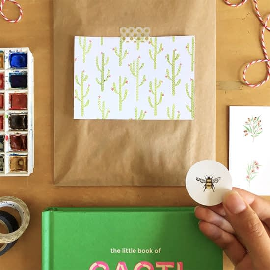 Andrina Menon packaging with postcard and sticker