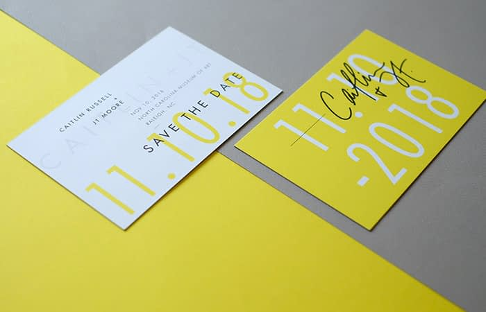 The Letterist yellow save the date cards