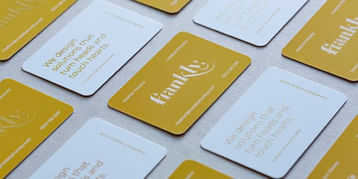 Mosaic of Frankly spot UV business cards