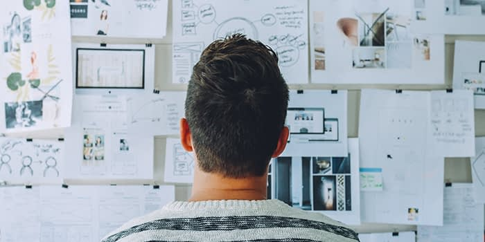 person looking at ideas on wall