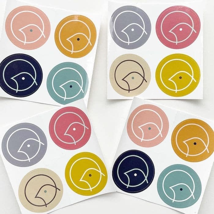 4 sheets of 4 round stickers in various colors with a bird logo by Lark party