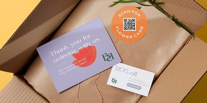 Mauve thank you postcard, 20% off coupon and round orange sticker with a QR code by fictional brand Best Buds