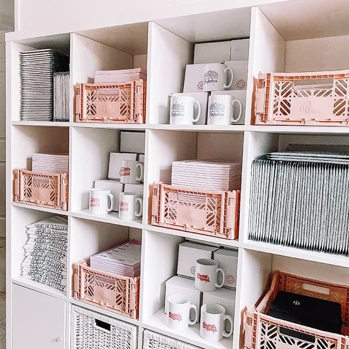 Lucy's Logos shop storage with mugs and prints