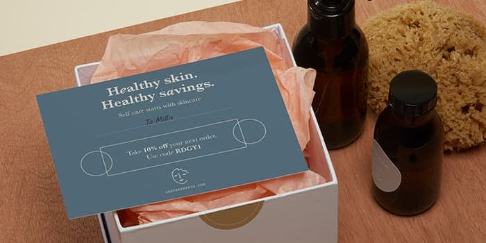 Promo card for a skincare brand on an open box