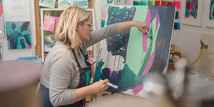 Sticks + Ink working in her studio
